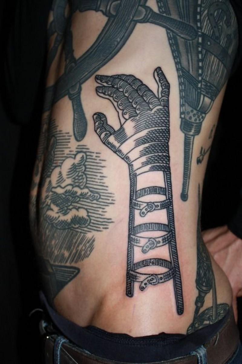 Interesting black and white futuristic cartoon like hand tattoo on side