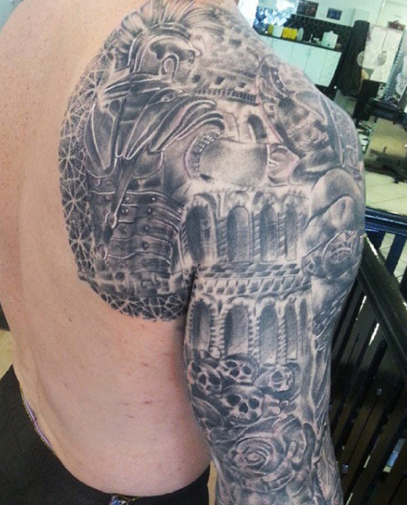 Interesting black ink detailed looking shoulder and sleeve tattoo of ancient warrior in dark dungeon