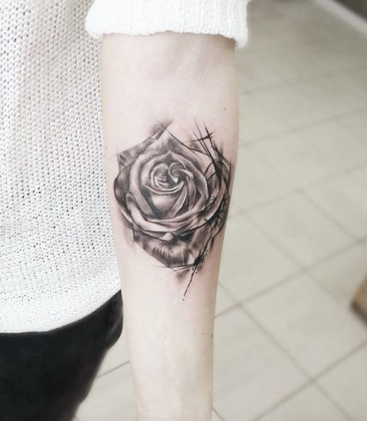 Interesting black ink forearm tattoo of corrupted rose flower