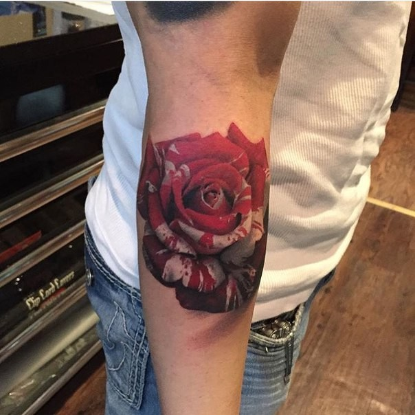 Interesting colored arm tattoo of large rose