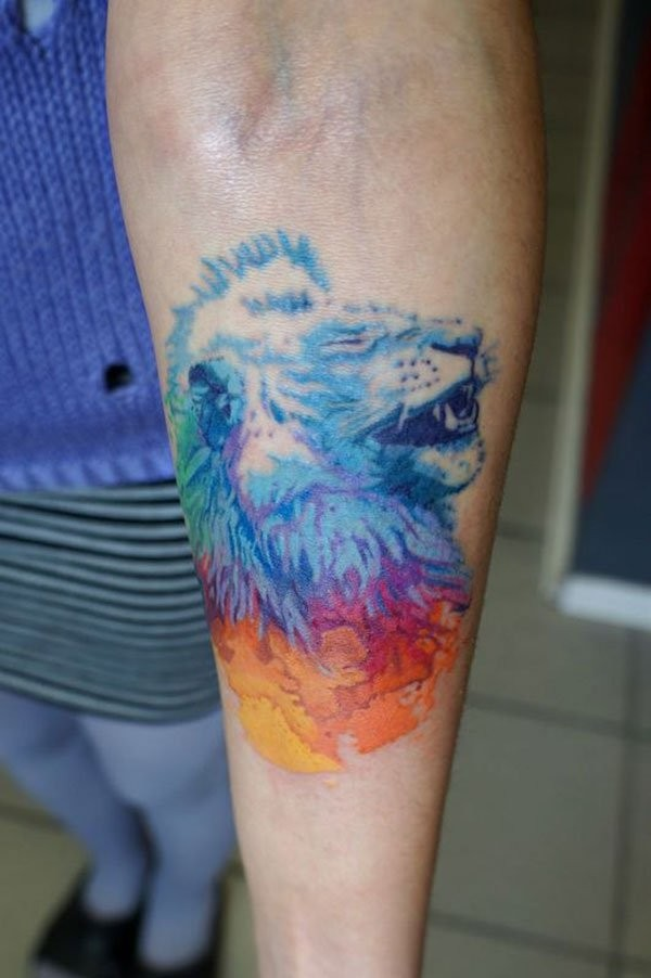 Interesting colored tiny forearm tattoo of lion head