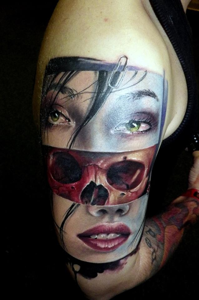 Interesting combined and colored shoulder tattoo of woman face with skull
