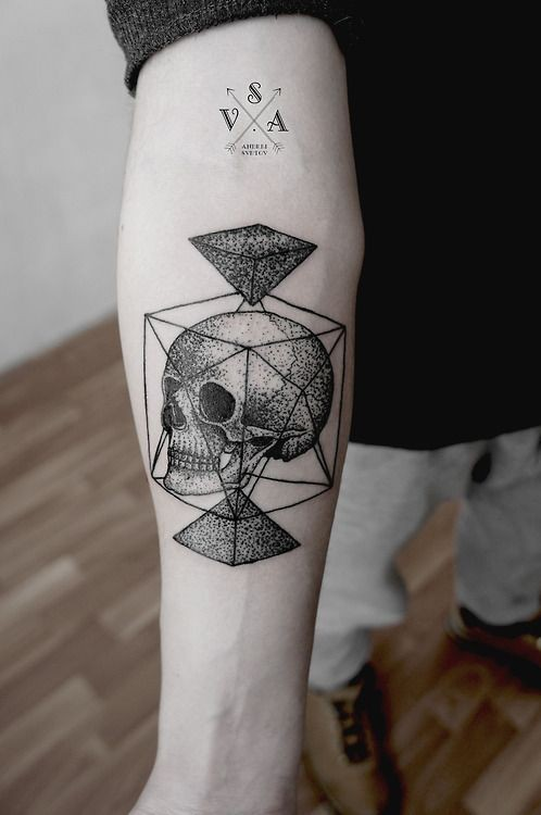 Interesting combined black and white geometric figures with skull tattoo on arm