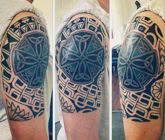 Interesting combined black ink tribal ornaments with colored Celtic cross half sleeve like tattoo