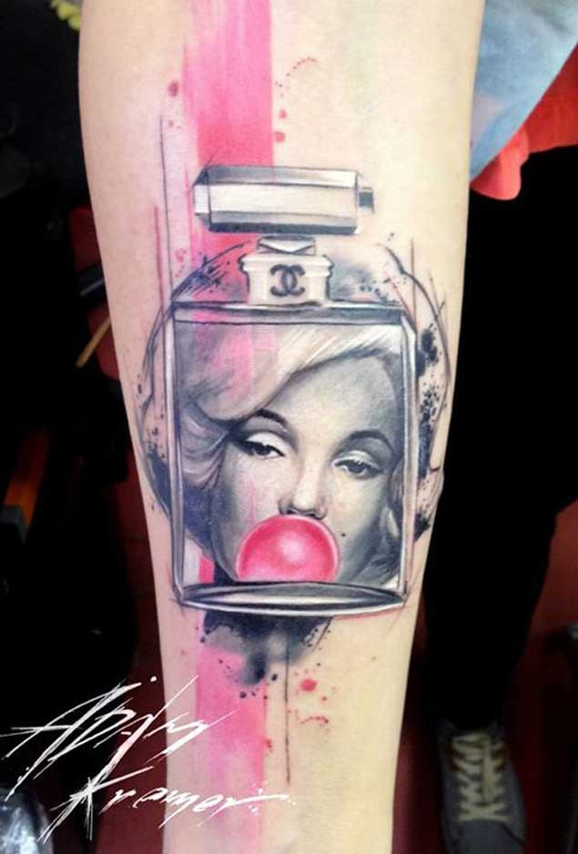 Interesting combined colored perfume bottle tattoo on forearm with Merlin Monroe portrait