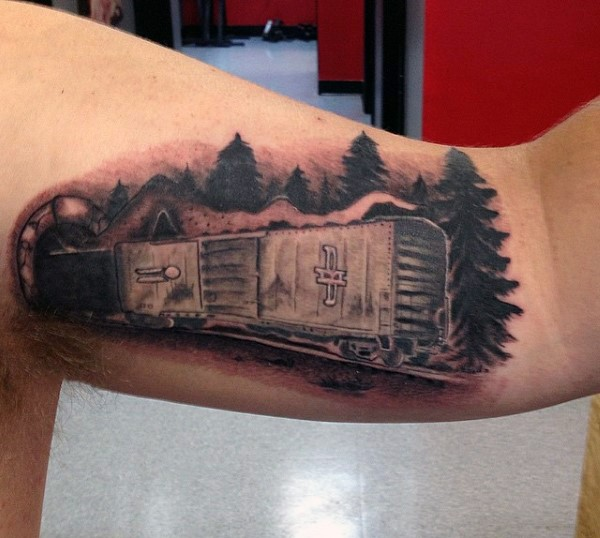 Interesting designed black ink train in tunnel tattoo on arm