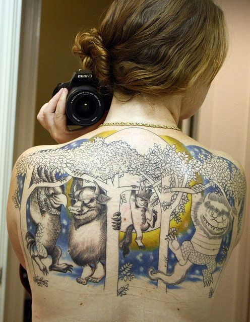 Interesting designed colored various fantasy monsters tattoo on upper back with trees and moon