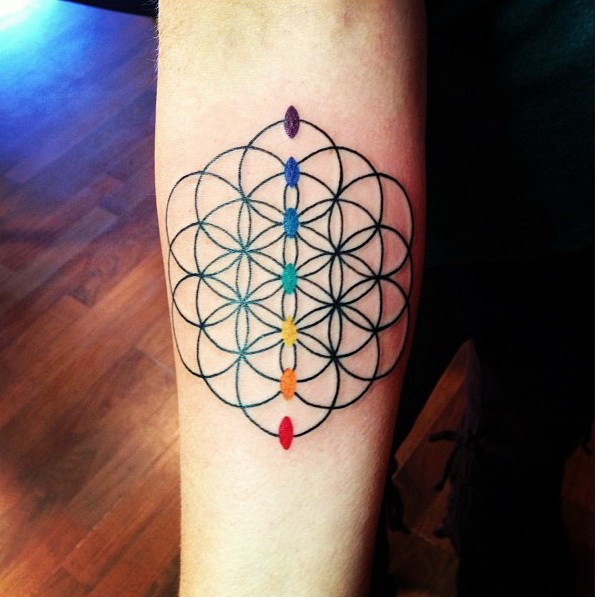 Interesting designed flower of life with chakras tattoo on arm