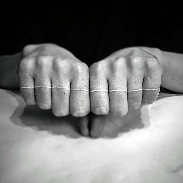 Interesting designed little white ink line tattoo on fingers
