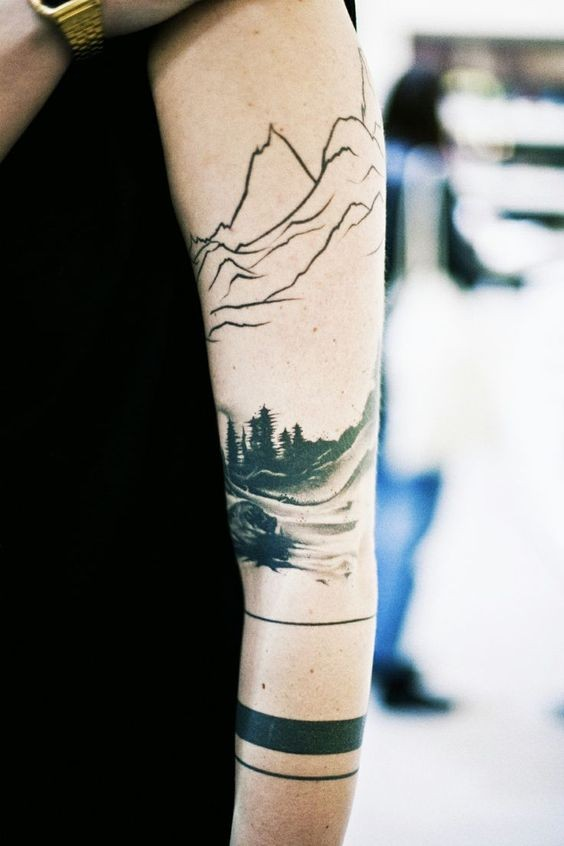 Interesting designed real photo like mountain forest tattoo on sleeve stylized with black lines