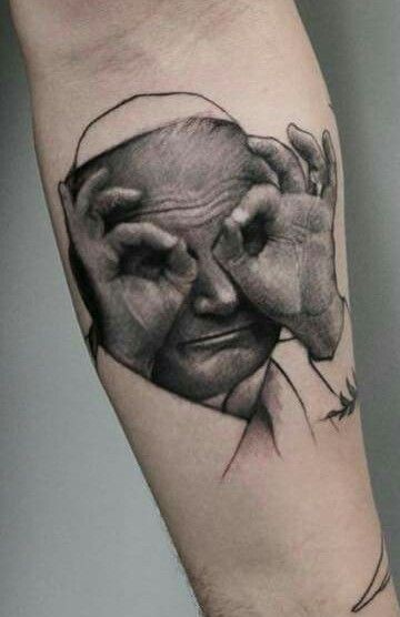 Interesting looking arm tattoo of funny Pope