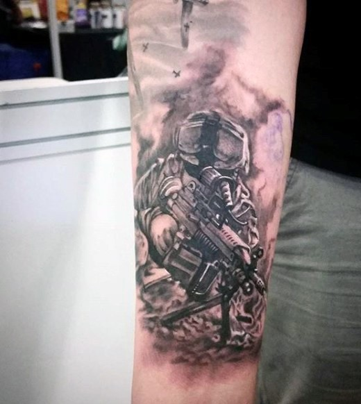 Interesting looking black and gray style forearm tattoo of modern soldier