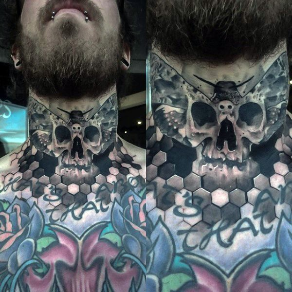 Interesting looking black ink human skull tattoo on neck stylized with butterfly wings
