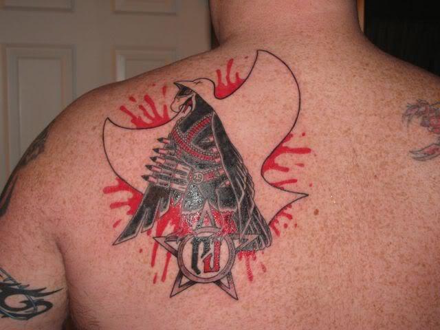 Interesting looking colored scapular tattoo of mystical emblem