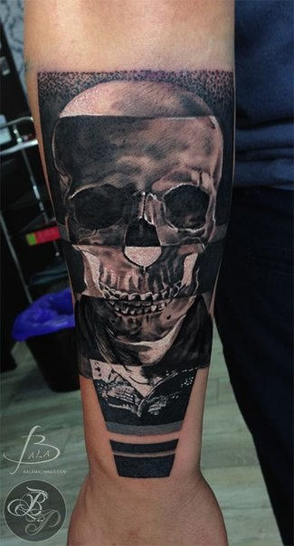 Interesting looking detailed forearm tattoo of cool looking skull