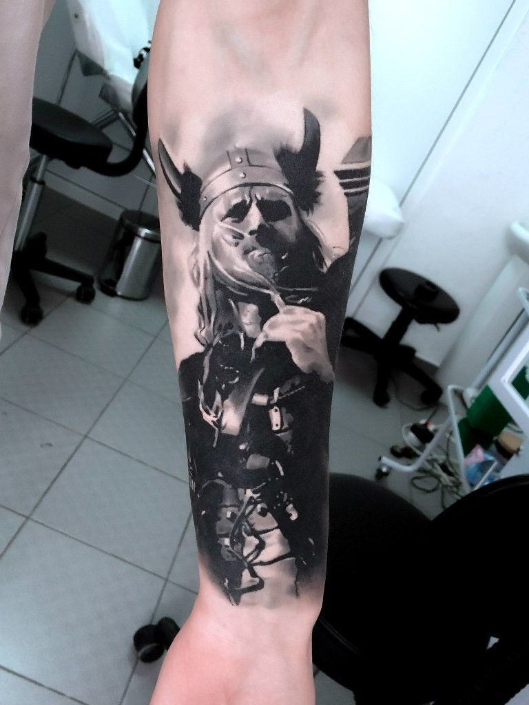 Interesting looking forearm tattoo of medieval viking warrior