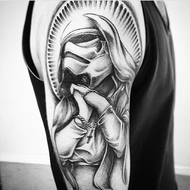 Interesting looking shoulder tattoo of storm troopers mother Mary