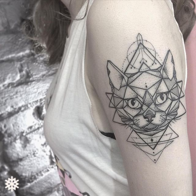 Interesting modern dot style shoulder tattoo of  cat with various figures