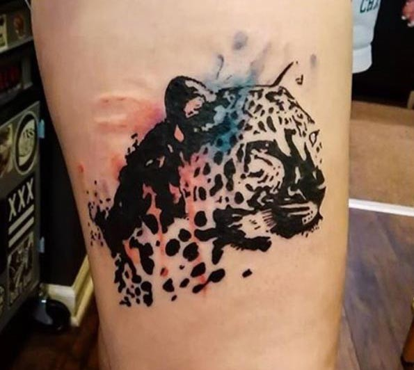 Interesting natural looking black ink arm tattoo of leopard