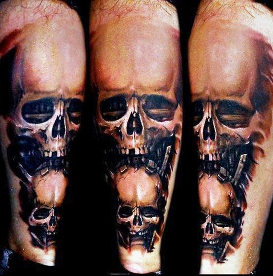 Interesting painted 3D style colored leg tattoo of human skulls