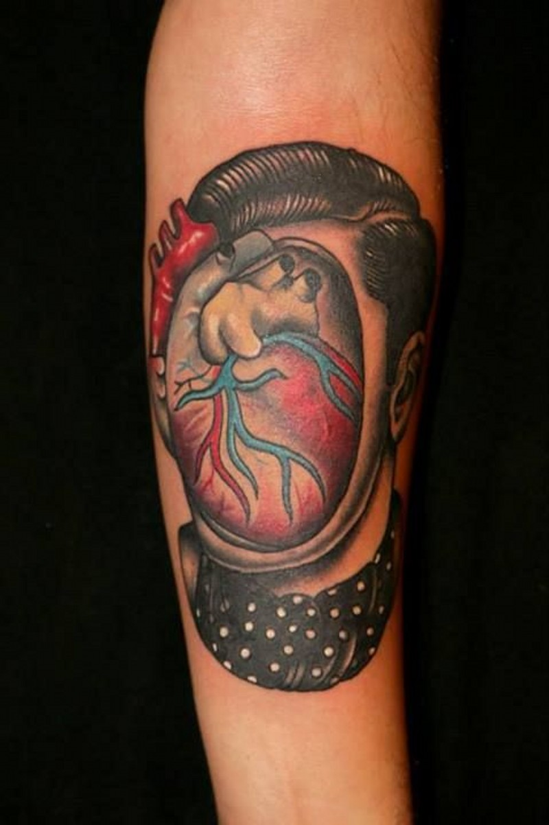 Interesting painted and colored faceless portrait with heart tattoo on arm