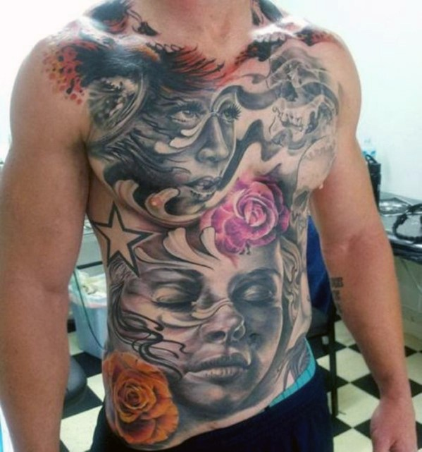 Interesting painted and colored massive tattoo with various portraits on chest and belly