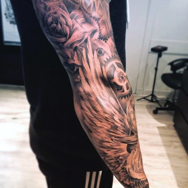 Interesting painted black and white mechanical tattoo on sleeve