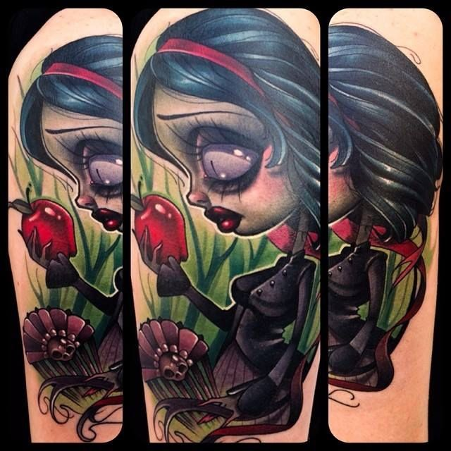 Interesting painted colorful little witch tattoo on arm with red apple