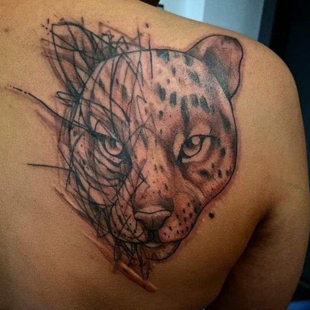 Interesting painted jaguar tattoo design idea
