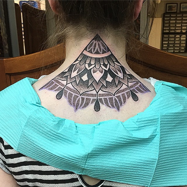 Interesting style painted and colored neck tattoo of ornamental flowers