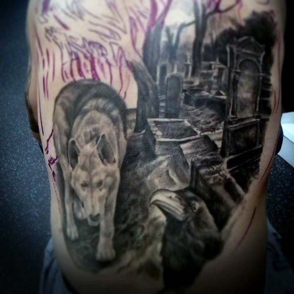 Interesting unfinished black and white wolf on cemetery tattoo on side