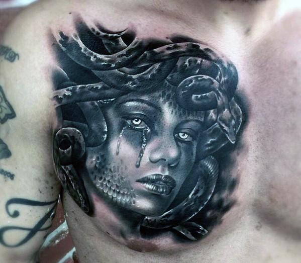 45 Intriguing Chest Tattoos For Men: Interesting Very Realistic Looking Medusa Portrait Tattoo
