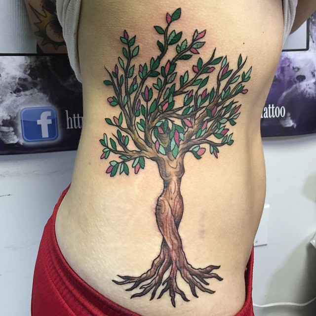 Interesting woman shaped colored fantasy tree tattoo on side area