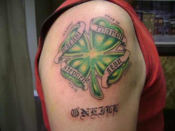 Irish clover with dates of birth tattoo on shoulder