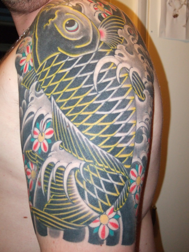Japanese koi fish tattoo on half sleeve