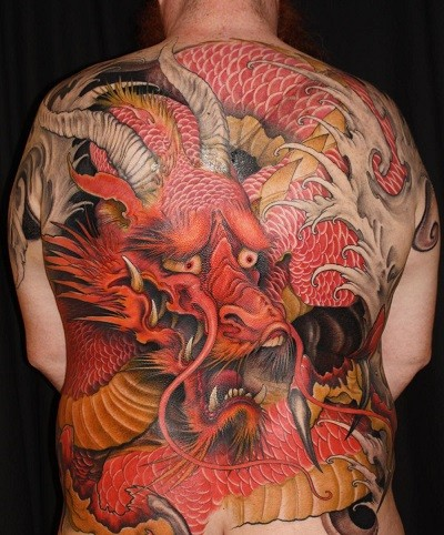Japanese style colored enormous colored whole back tattoo of fantasy dragon
