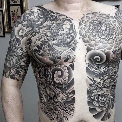 Japanese traditional black and white chest tattoo of tigers with flowers and masks
