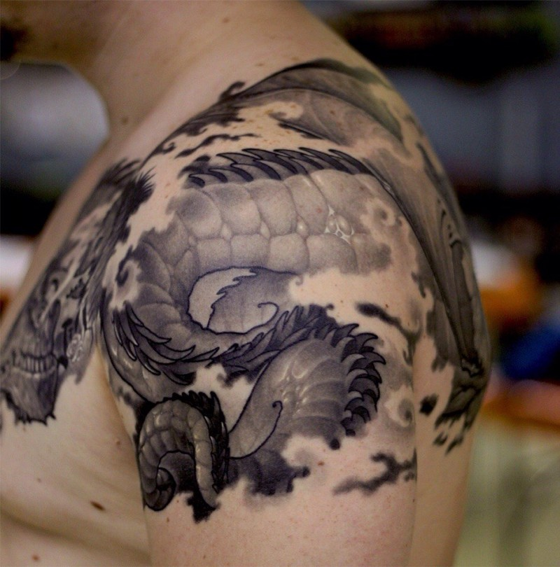 Japanese traditional black ink dragon tail tattoo on shoulder