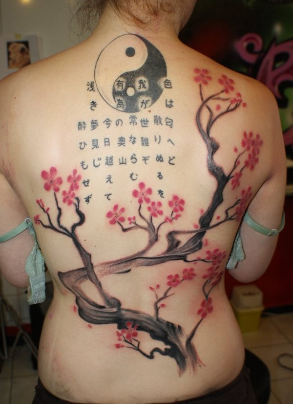 Japanese traditional colored whole back tattoo of blooming tree, lettering and symbol