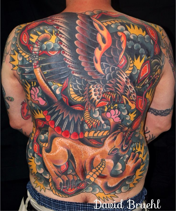 Japanese traditional style colorful massive whole back tattoo of eagle fighting lion
