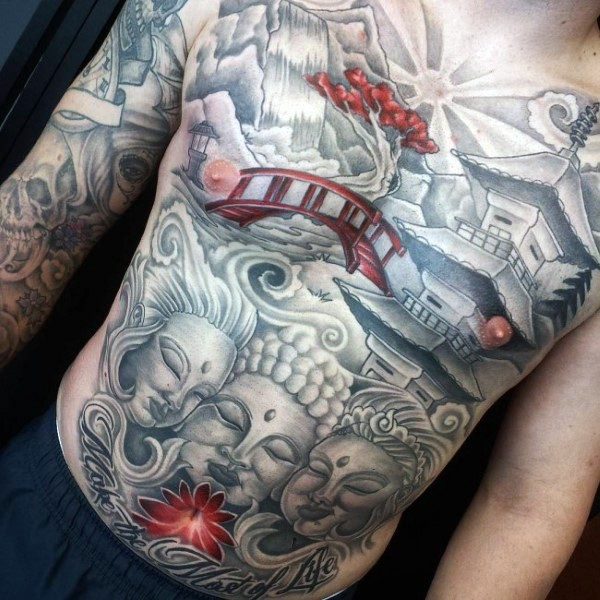 Japanese traditional style typical colored whole chest and belly tattoo of Buddha statue with old mountain temple