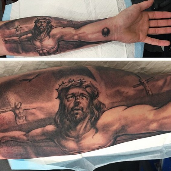 Jesus Christ Suffering On Crucifix Forearm Length Religious Tattoo Tattooimages Biz It is a stylized fish that is the symbol of christ because of several biblical references. jesus christ suffering on crucifix