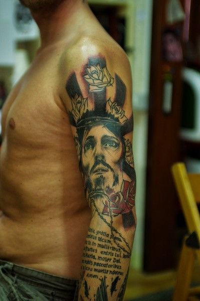 Jesus with red roses and text of bible tattoo on shoulder