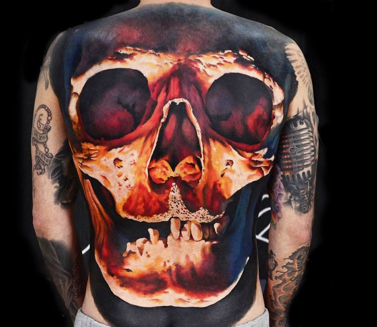 Large 3D style colored back tattoo of big human skull