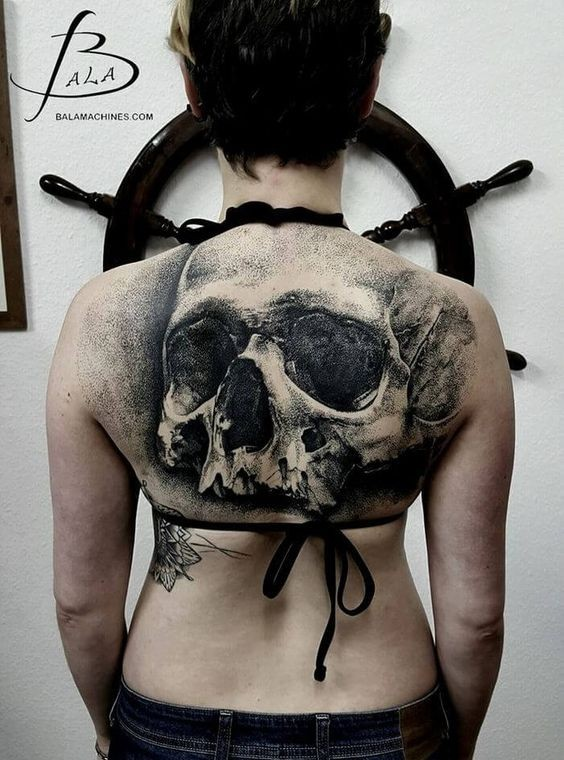 Large 3D style upper back tattoo of human skull