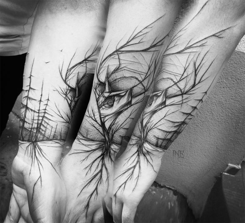 Large accurate painted black ink forearm tattoo of mysterious forest trees