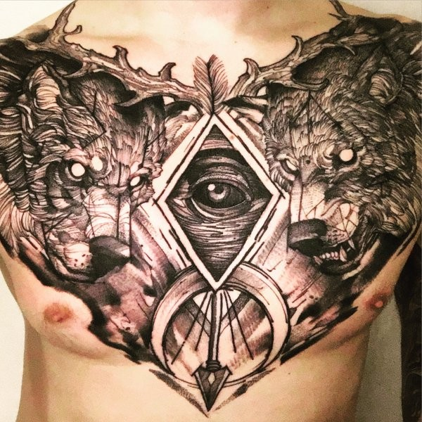 Large amazing looking black ink chest tattoo of demonic wolves and arrow head