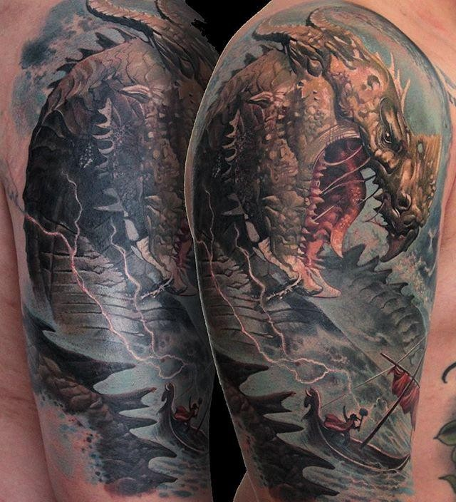 Large beautiful looking shoulder tattoo of fantasy dragon and boat