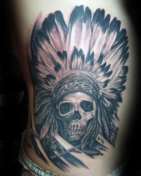 Large black and gray style side tattoo of big Indian skull with big feather helmet