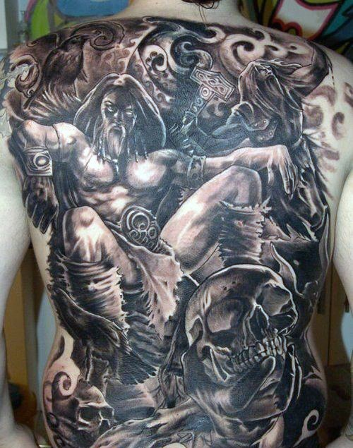 Large black and gray style whole back tattoo of fantasy warrior with skull